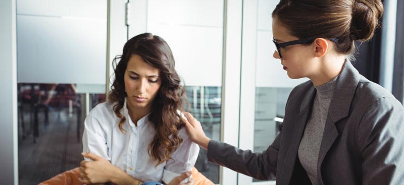 woman being comforted by a medical professional - detoxification services - alcohol and drug detox for adults