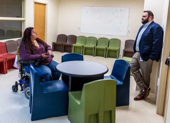 two adults talking in day room at Highland Hospital - West Virginia behavioral health treatment center